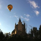 Flying on hot air balloon over Alcazar Castle Segovia